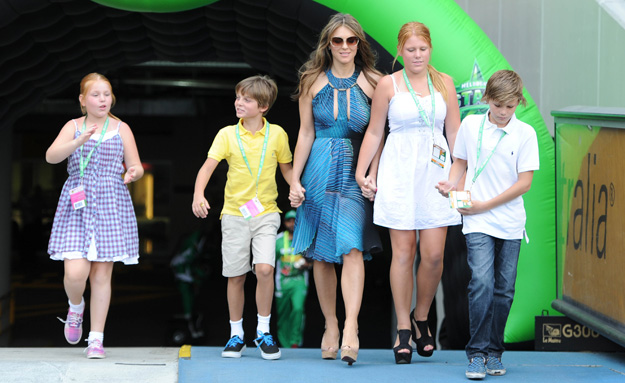 Liz Hurley plays happy families with Shane Warne's kids